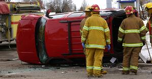 Plaintiff v. Allstate image of car tipped on the side with firefighters surrounding it after a car accident