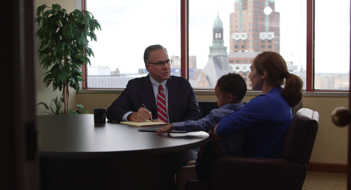 Personal injury attorney meeting with a family