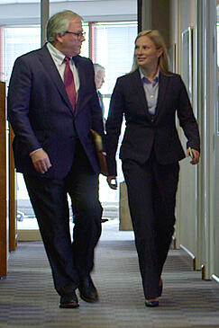 Personal Injury Attorney Michelle Hockers walking with client in office hallway