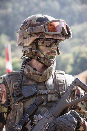 Military service member in gear shown to represent 3M ear plug lawsuit | photo by Jan Abellan via Unsplash
