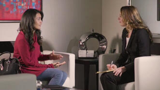 Personal injury lawyer and client sit down for one-on-one meeting